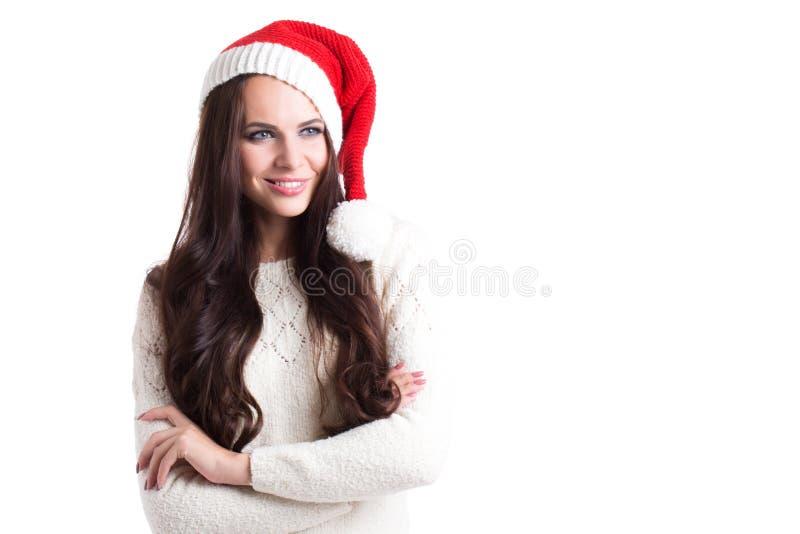 Belle femme de sourire dans le chapeau de Santa images libres de droits