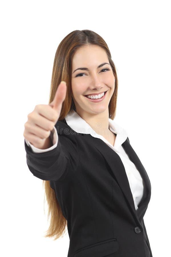 Belle femme heureuse d'affaires faisant des gestes le pouce  image libre de droits