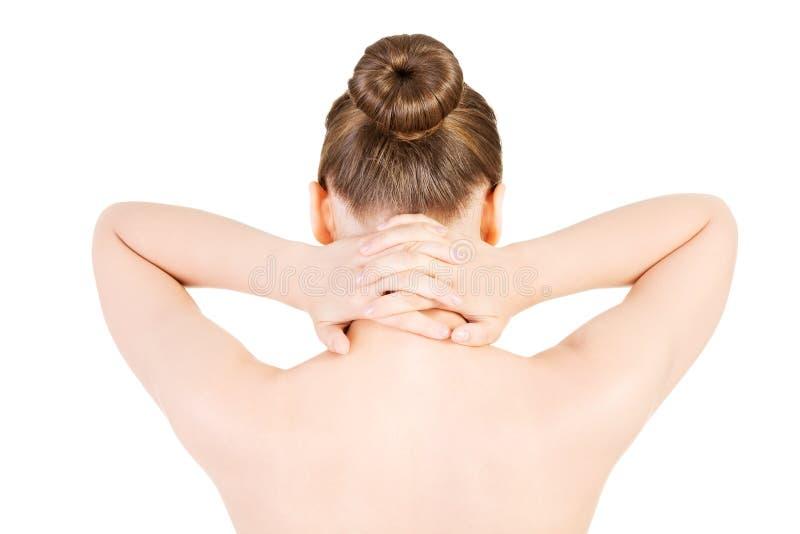 Belle femme nue tenant son cou. Vue arrière. photographie stock libre de droits