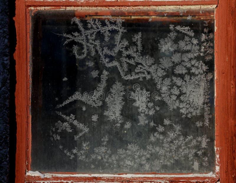 Belle figure congelate in finestra immagine stock
