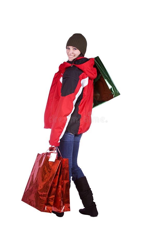 Belle fille avec des sacs à provisions photographie stock