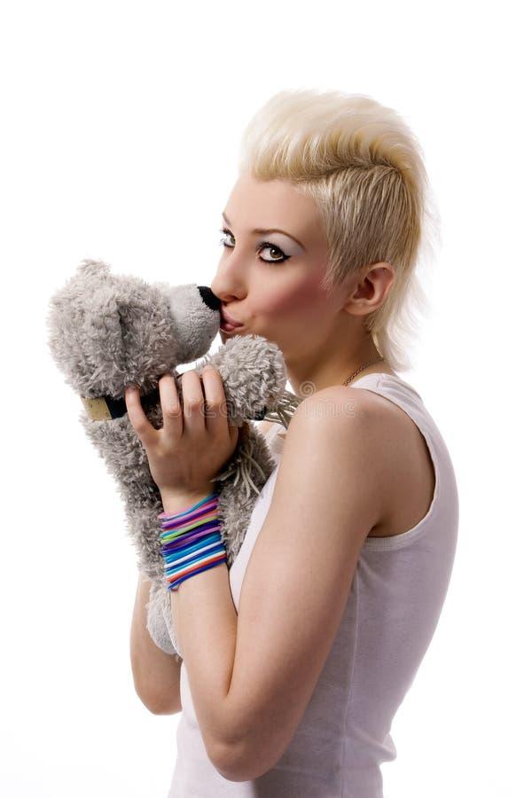 Belle fille avec le cheveu blond et le nounours photo stock