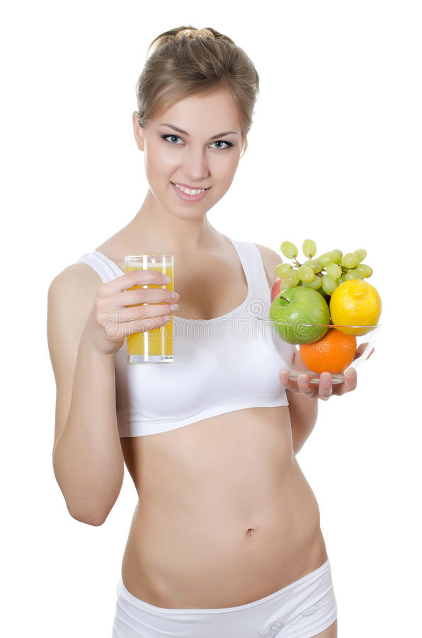 Belle fille avec le fruit et le jus photo stock