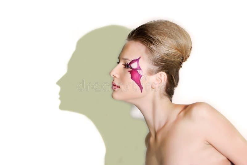 Belle fille avec le visage pourpré d'art de visage photos libres de droits