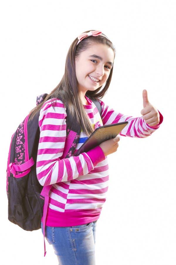 Belle fille d'adolescent avec le sac à dos et le comprimé numérique photos libres de droits