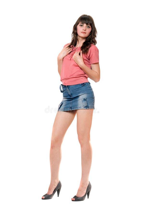 belle fille dans la mini jupe de jeans image stock image du mini jupe 23148359. Black Bedroom Furniture Sets. Home Design Ideas