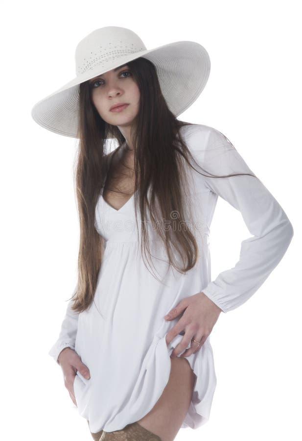 Belle fille dans un blanc photo stock