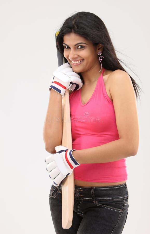 belle fille de cricket de 'bat' photo libre de droits
