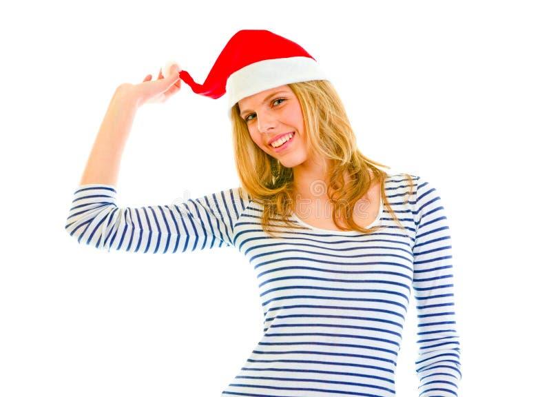 Belle fille de l'adolescence espiègle dans le chapeau de Santa image stock