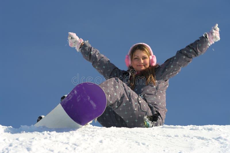 Belle fille de snowboarder photographie stock libre de droits