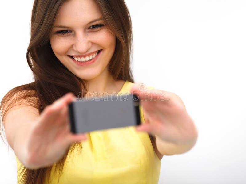 Belle fille prise prenant l'autoportrait de selfie avec le pho d'appareil-photo images libres de droits
