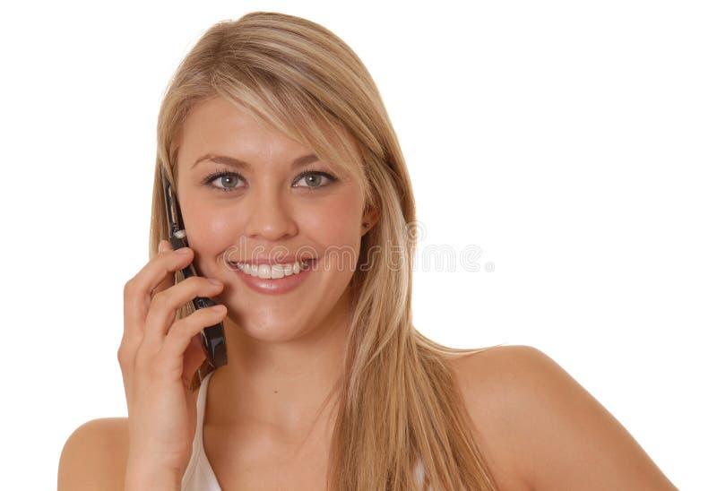 Belle fille sur le téléphone portable image stock
