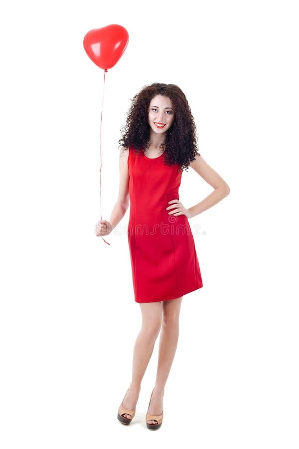 Belle fille tenant le ballon rouge photo stock