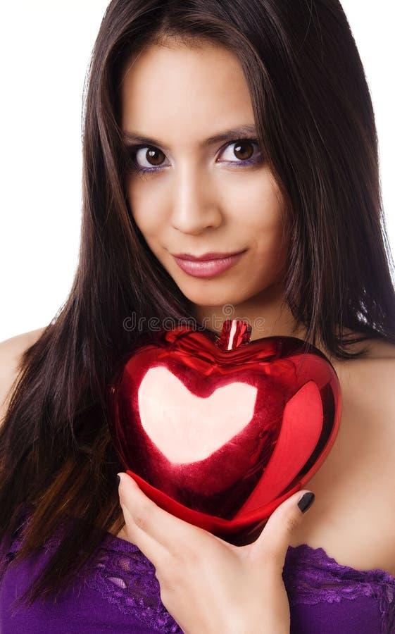 Belle forme de coeur de fixation de jeune femme image libre de droits