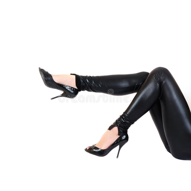 Belle gambe femminili in lattice fotografia stock