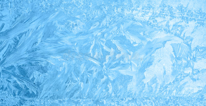 Belle glace d'hiver, texture bleue sur la fenêtre, fond de fête photographie stock