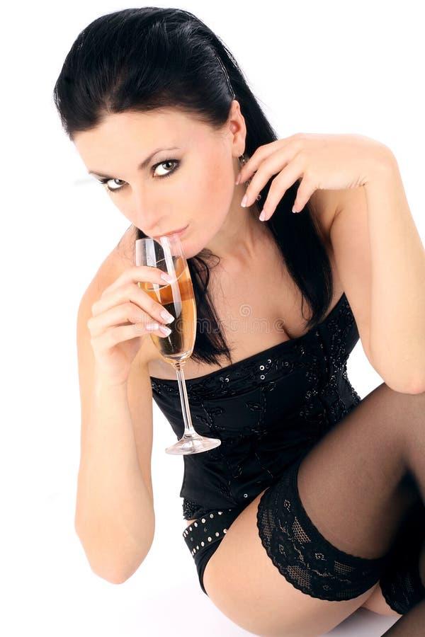belle glace de champagne de brunette image libre de droits