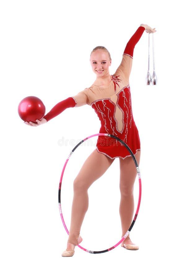 Belle gymnaste de fille avec une bille image libre de droits