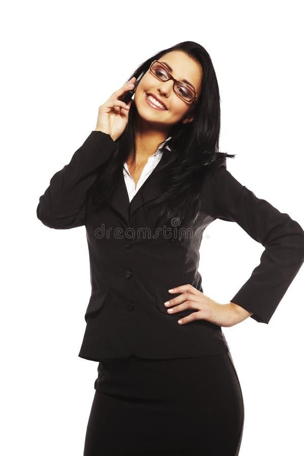 Belle jeune femme appelant par le mobile photo stock