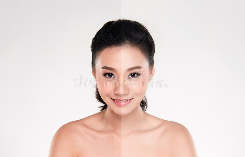 Belle jeune femme asiatique sur le fond blanc photographie stock libre de droits