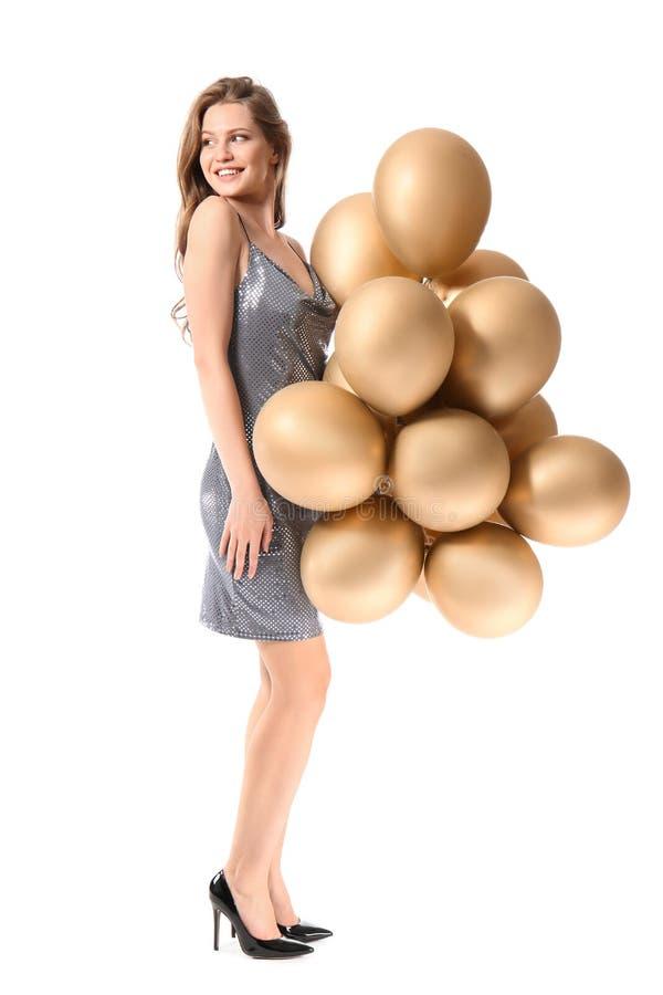 Belle jeune femme avec des ballons sur le fond blanc photo libre de droits
