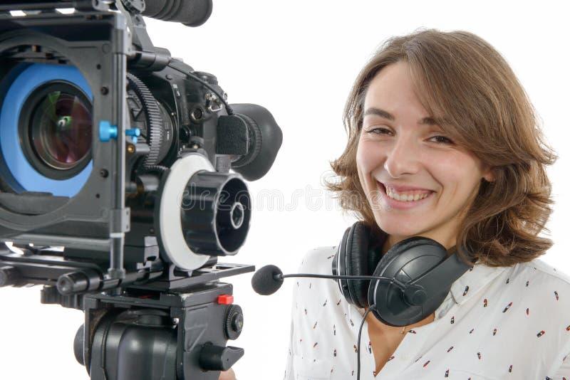 Belle jeune femme avec la caméra vidéo de SLR images stock