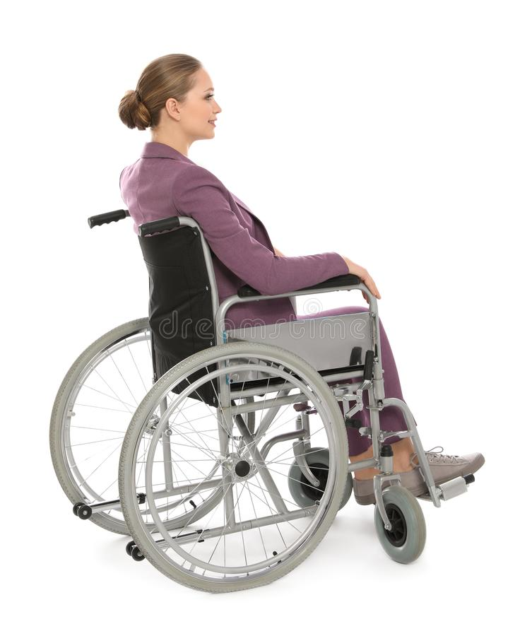 Belle jeune femme d'affaires dans le fauteuil roulant d'isolement photos libres de droits