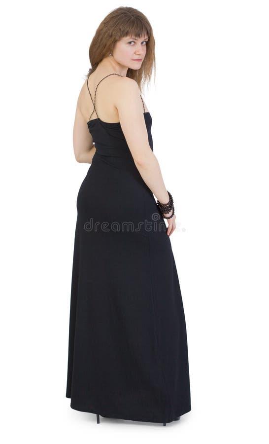 Belle jeune femme dans la longue robe foncée photo libre de droits