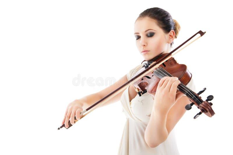 Belle jeune femme jouant le violon au-dessus du blanc photographie stock libre de droits