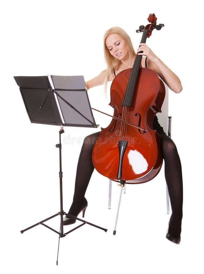 Belle jeune femme jouant le violoncelle image stock