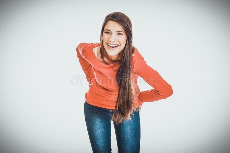 Belle jeune femme riante d'étudiant image libre de droits