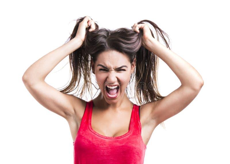 Femme saisissant ses cheveux photos stock