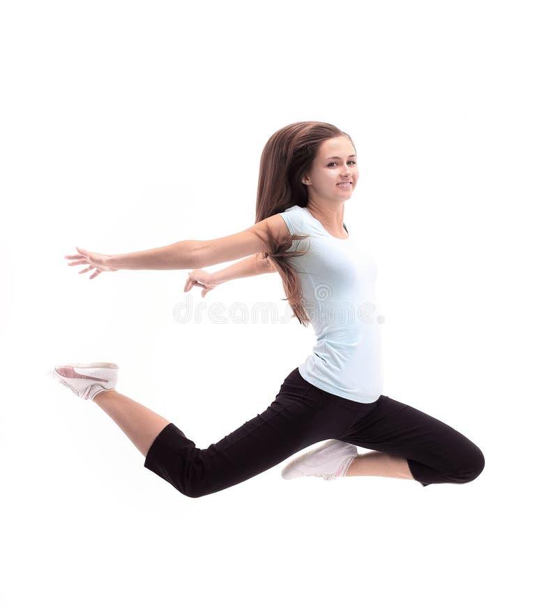 Belle jeune femme sportive photo sautante D'isolement sur le blanc image libre de droits