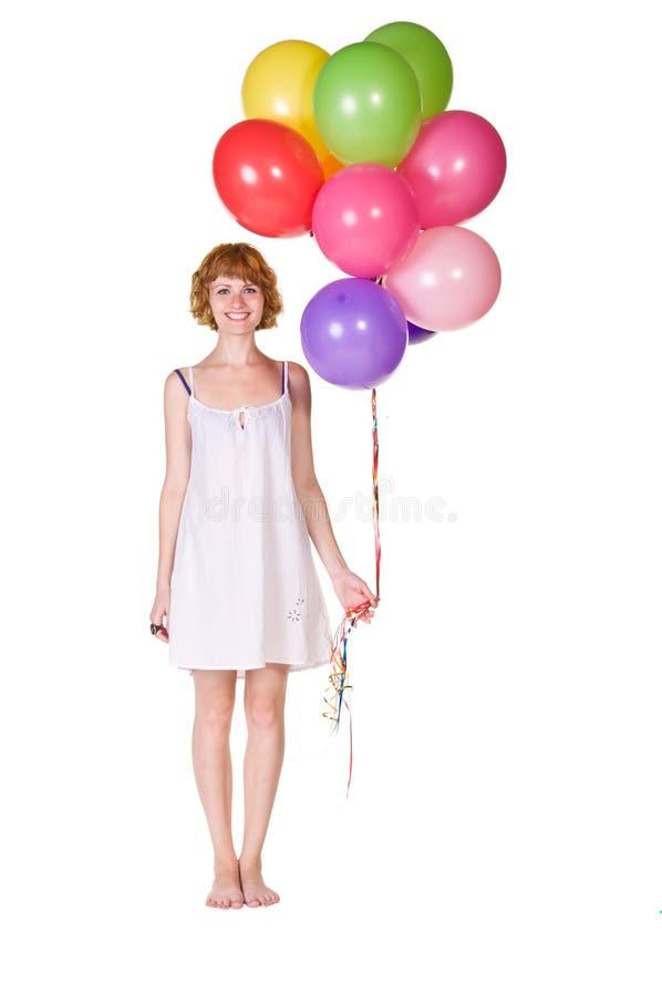 Belle jeune fille avec des ballons à disposition photographie stock