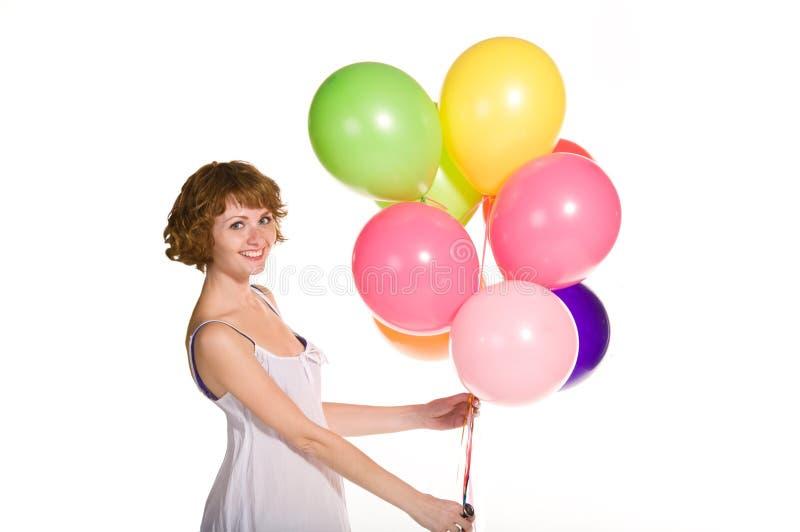Belle jeune fille avec des ballons à disposition photographie stock libre de droits