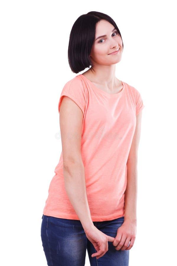 Belle jeune fille avec les cheveux noirs courts d'isolement sur un fond blanc image libre de droits
