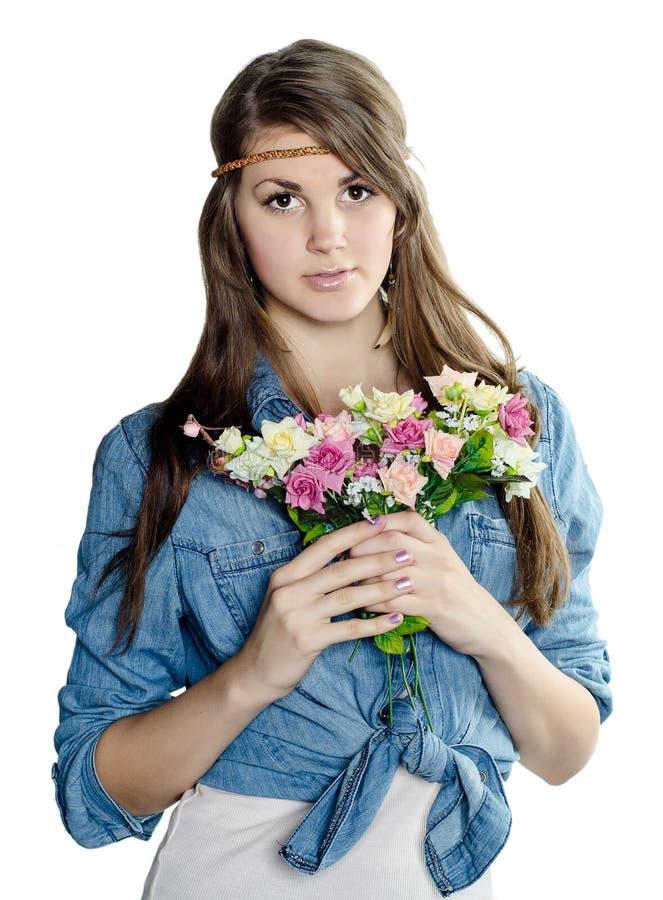 Belle jeune fille avec un bouquet photo stock
