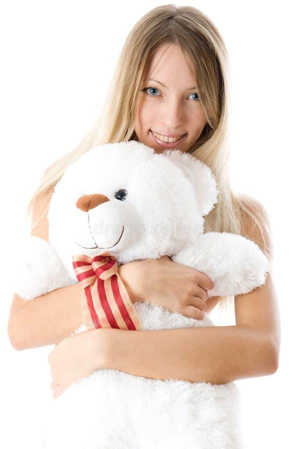 Belle jeune fille blonde avec l'ours de nounours photo stock