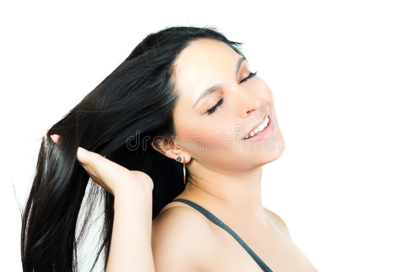 Belle jeune fille de brune touchant son lisse photos stock