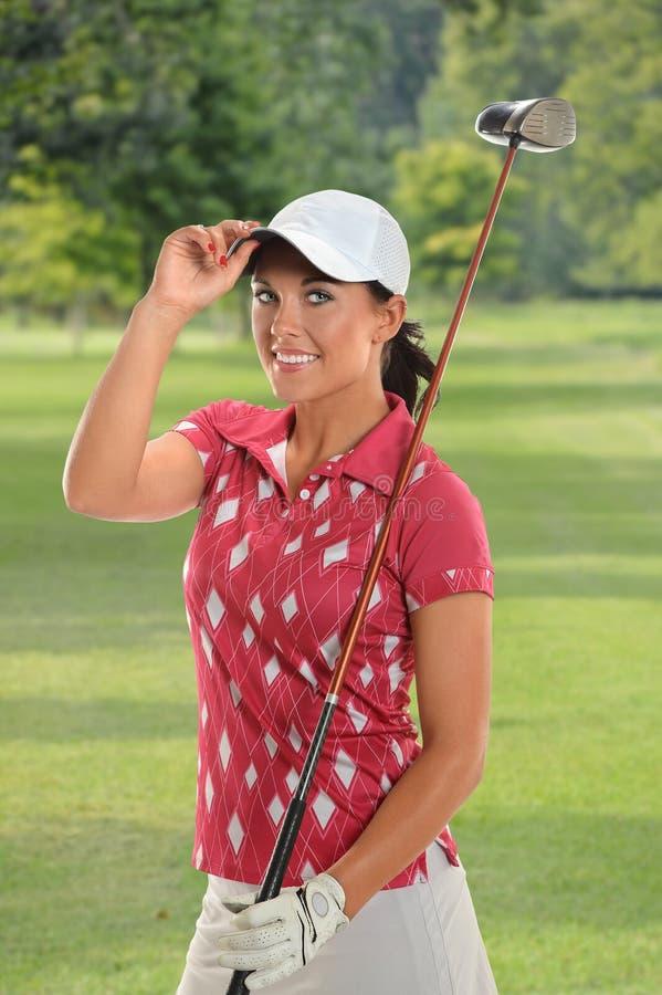 Belle jeune salutation de golfeur photo libre de droits