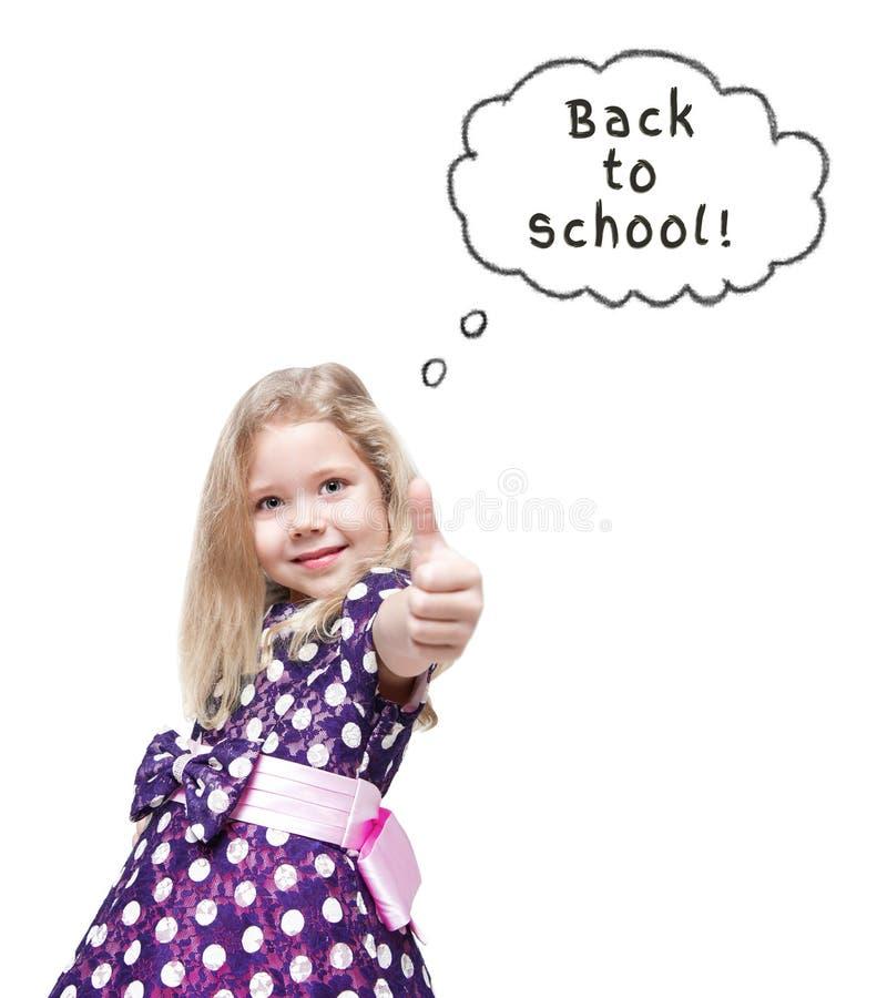 Belle petite fille affichant des pouces vers le haut De nouveau au concept d'école photographie stock libre de droits