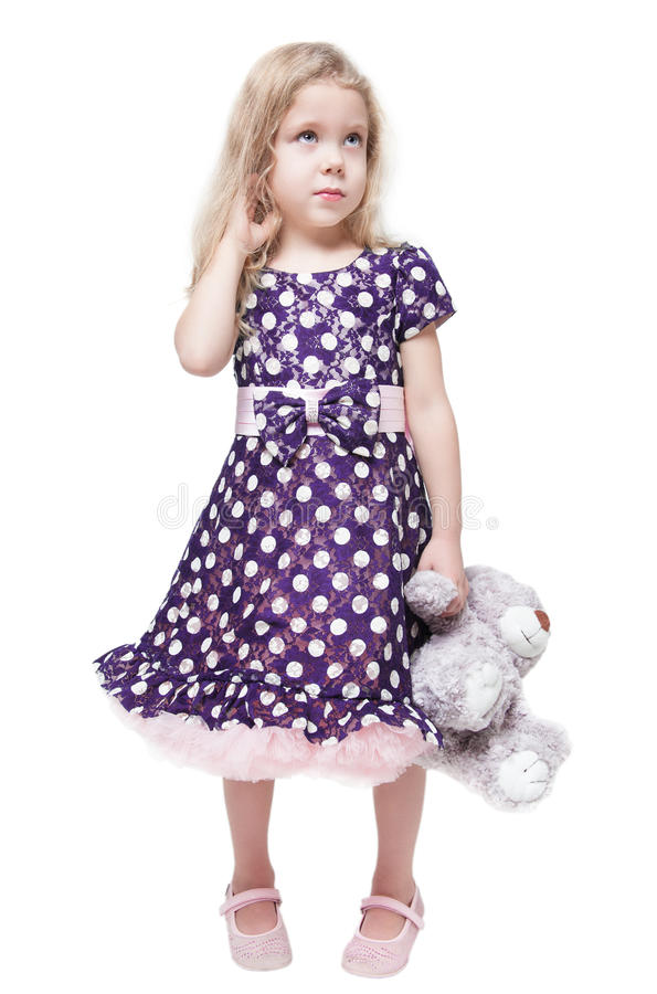 Belle petite fille avec l'ours de nounours d'isolement photos libres de droits