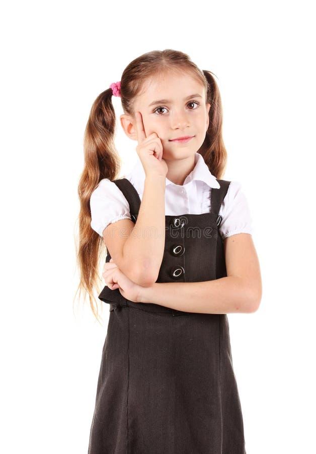 Belle petite fille dans l'uniforme scolaire photos stock