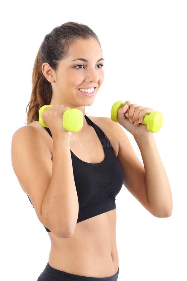 Belle pratique en matière de femme de forme physique aérobie avec des haltères photos libres de droits