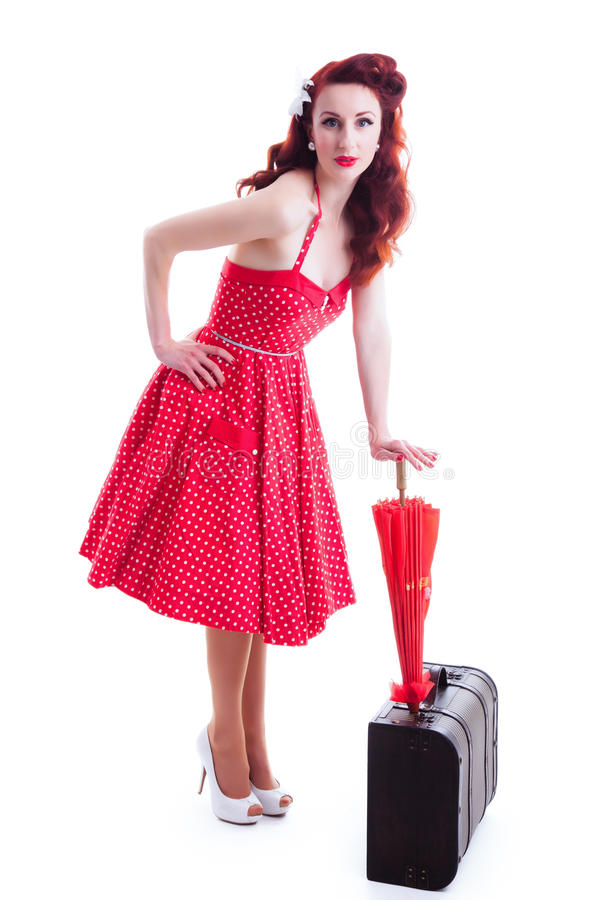 Belle rétro fille de goupille- avec la robe rouge de point de polka images stock
