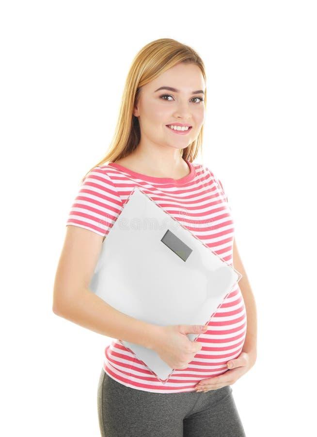 Belle scale della tenuta della donna incinta fotografia stock libera da diritti