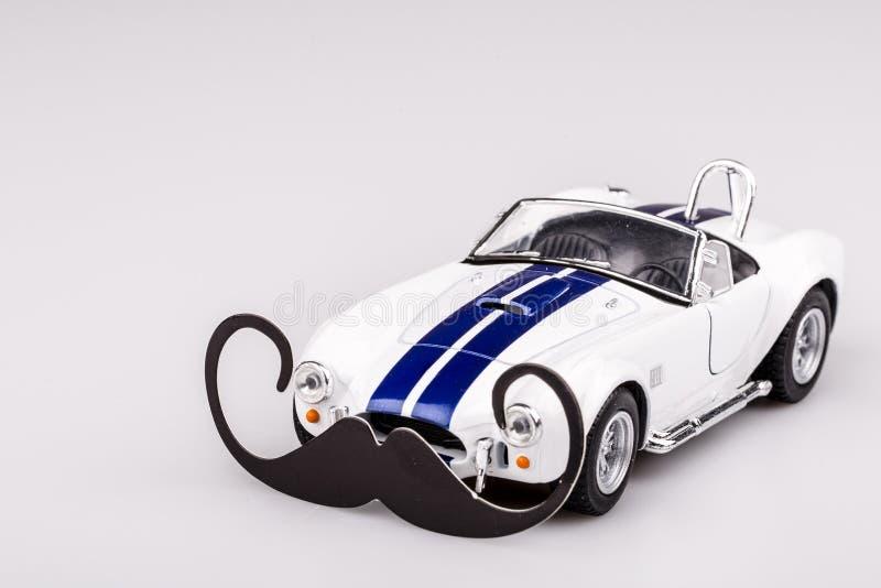 Belle voiture bleue et blanche, roadster avec la moustache photo libre de droits