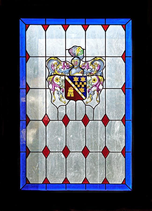 Belles couleurs d'un hublot en verre souillé images libres de droits