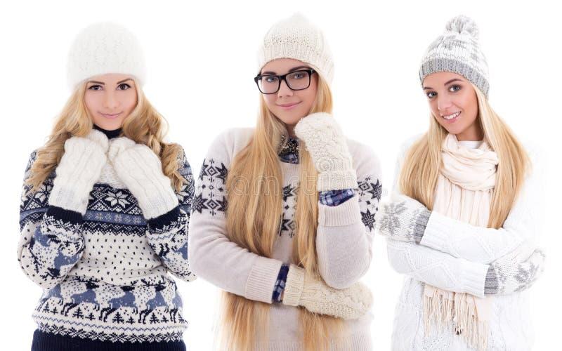 Belles filles mignonnes dans des vêtements d'hiver d'isolement sur le blanc image libre de droits