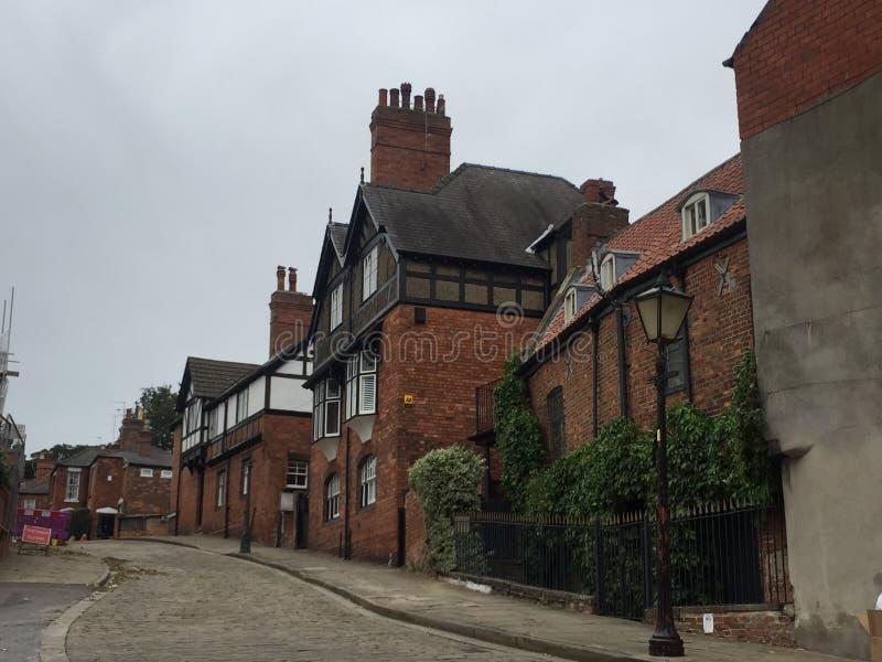 Belles vieilles maisons de pierre et de brique dans Lincoln image libre de droits